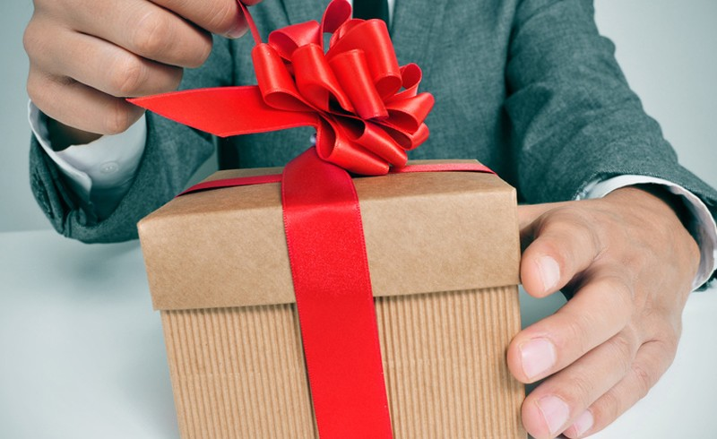man-opening-gift-present