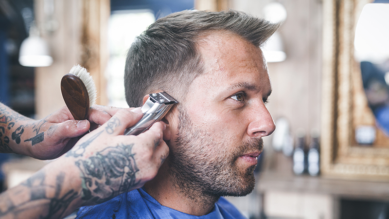 bluebeards revenge team up with interserve learning support to train apprentice barbers