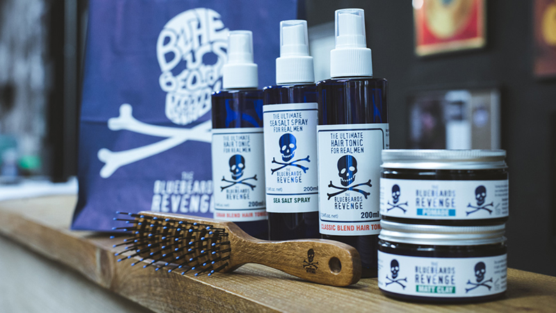 bluebeards revenge hairstyling products in a barbershop