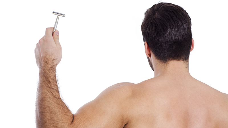 A man shaving his back with a double-edge razor by bluebeards revenge