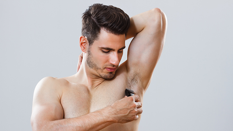 a man shaving his armpits