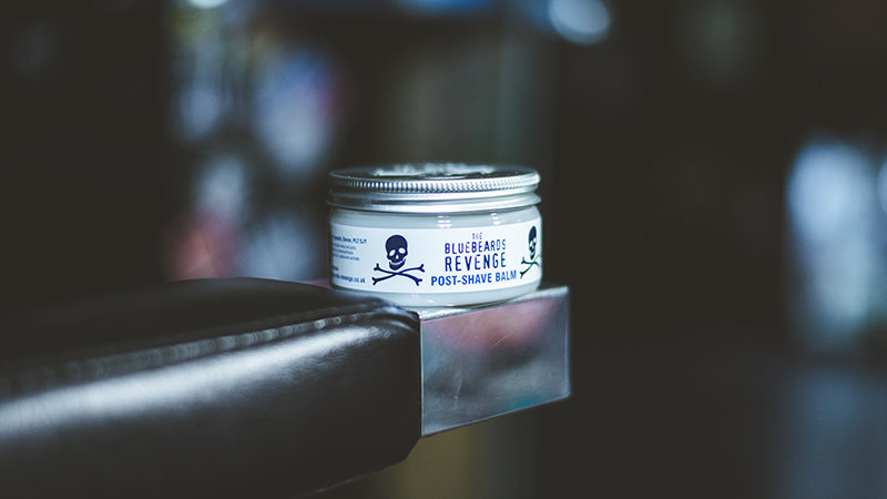 bluebeards revenge post-shave balm on a barber chair in a barbershop