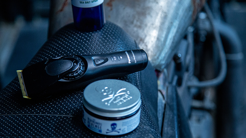 Bluebeards Revenge products and Panasonic clippers on a motorbike in a barbershop