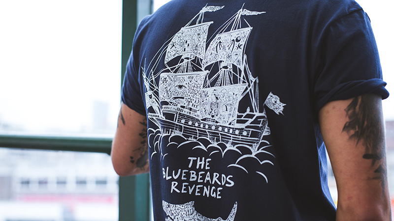 Close-up of the tattoo art detail on the back of the Bluebeards Revenge crew neck unisex t-shirt