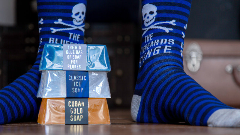100% cotton striped blue and black skull and crossbones men's socks by the bluebeards revenge