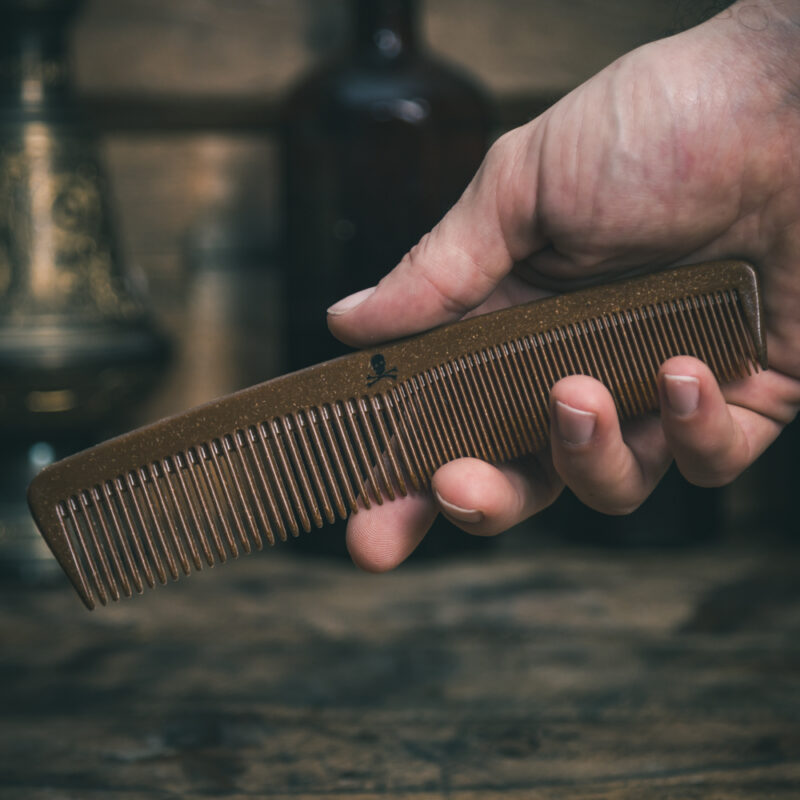 Liquid Wood Plastic Free Hair Styling Comb in a man's hand by The Bluebeards Revenge